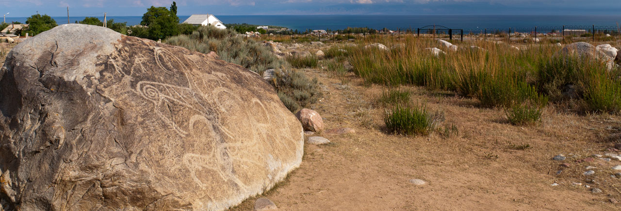 Petroglyph site in Cholpon Ata with lake Issyk Kul in the background
